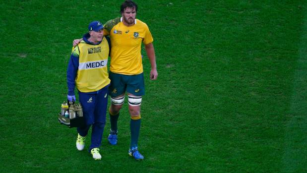 Kane Douglas of Australia walks off the field injured during the World Cup final.