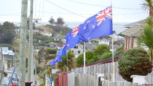 New Zealand flags fly high on Lagan St in Bluff, which some locals think should be renamed Flagan St.