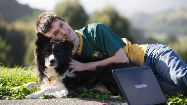 Michael Turner, with dog Softy, now studies from home after a diagnosis of fibromyalgia.