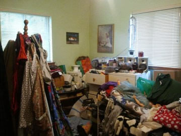 cluttered spare room