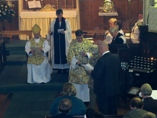 Canon Allan Maclean is presented with a Bible by Anne Clutterbuck and Holy Oils by Barnaby Miln at his Institution on St Vincent's Day, 22 January 2015