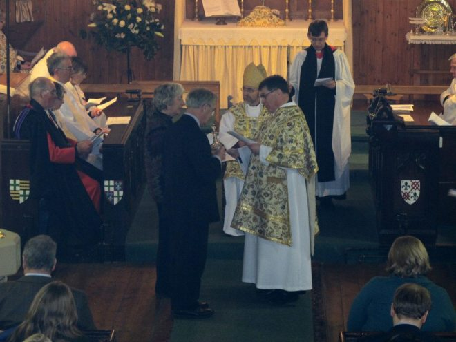 Patricia and Dermot Quinn present the communion vessels to Canon Allan Maclean during his Institution Eucharist as Rector of St Vincent's on St Vincent's Day, 22 January 2015