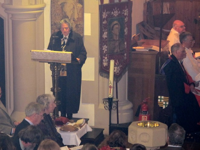 Susan Paul reads the Epistle during the Institution Eucharist of Canon Allan Maclean as Rector of St Vincent's on St Vincent's Day, 22 January 2015