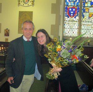 Vestry member, James Holloway presents flowers, speaking in Italian, to Mrs Eleonora Hull.