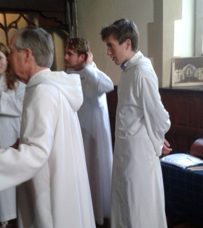 Our Sacristan, Christopher Hartley, with Augusta, Matthew and Lochie prior to Sunday Eucharist in August 2015.