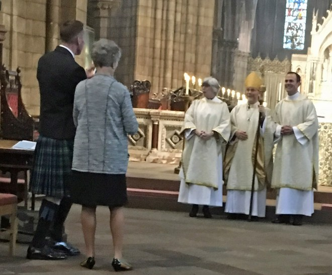 Oliver Brewer-Lennon's husband Joe and Mother, from the USA, watching Oliver who is on the right of the Bishop of Edinburgh following ordination as a deacon in the Scottish Episcopal Church on 25th September 2016. Oliver was on a research placement at St Vincent's in the Spring of 2016.