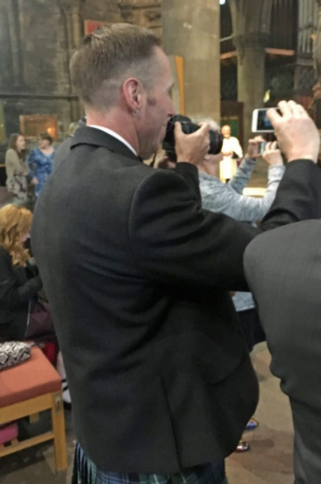 Oliver's husband Joe taking photographs in the Cathedral