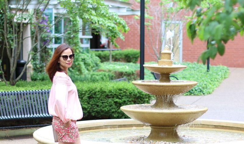 pink off shoulder top, floral shorts, Prada brow bar sunglasses