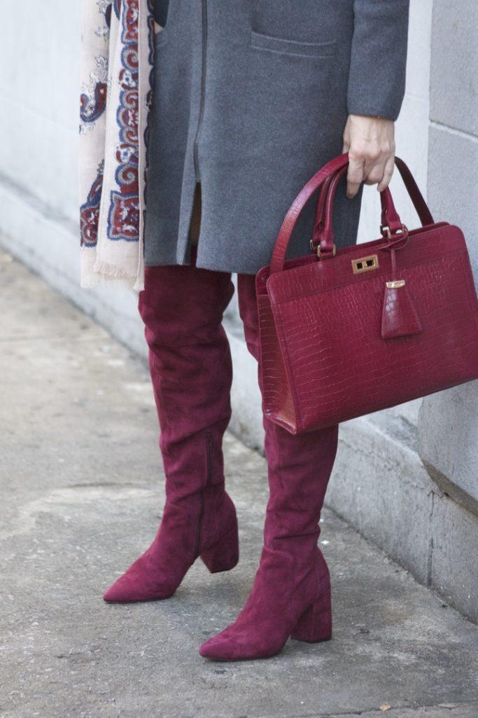burgundy boots and statement handbag