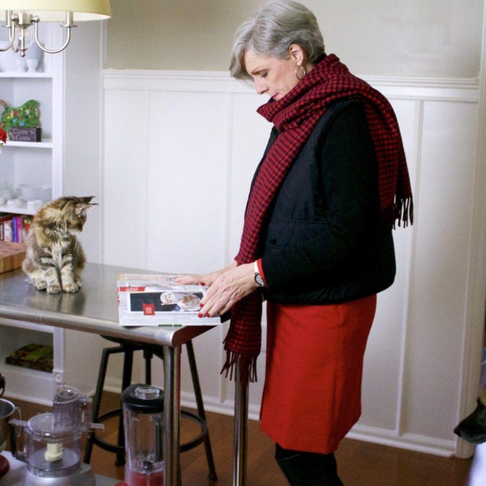 talbots red skirt, talbots cashmere crewneck, ralph lauren puffer vest, over the knee boots