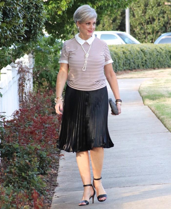 karl lagerfeld striped blouse black pleated skirt, black sandals, clutch