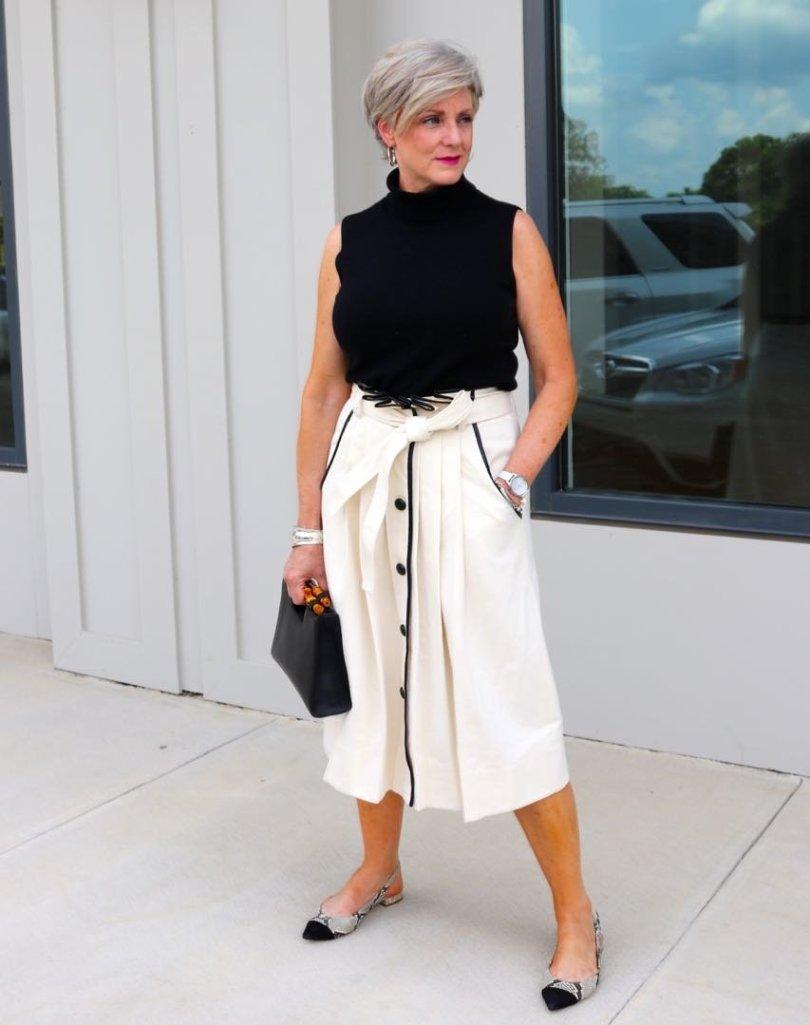 pleated cone denim skirt, black sleeveless turtleneck,