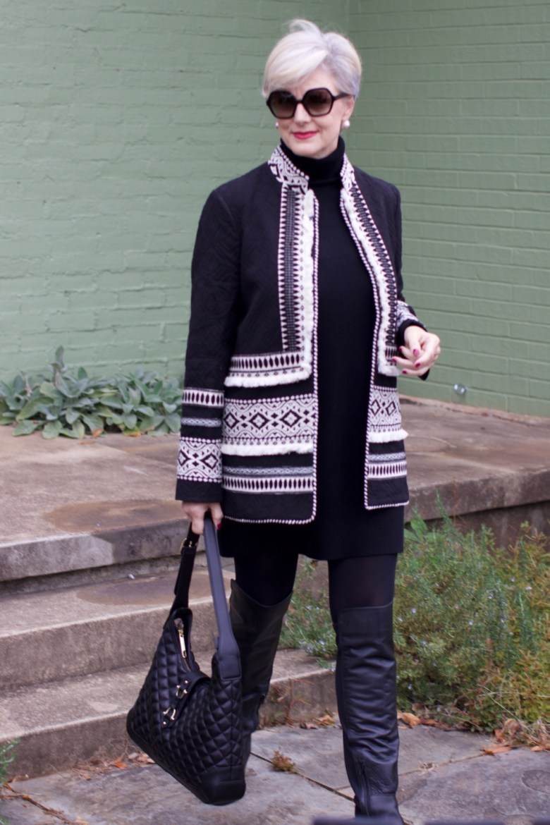 beth from style at a certain age wears a cashmere sweater dress from everlane, anthropologie embroidered jacket, black over the knee boots