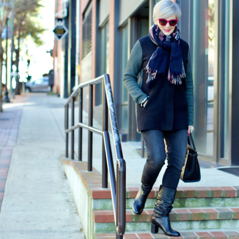 beth from Style at a Certain Age wears an Everlane cashmere waffle square turtleneck, J.Crew Factory black high rise skinny jean, Ann Taylor coatigan, Via Spiga black slouchy boots, Ralph Lauren black handbag, and wool scarf