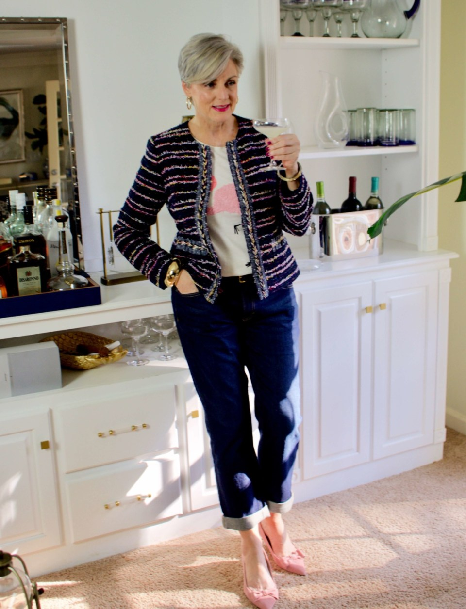 beth from Style at a Certain Age wears boyfriend jeans, graphic tee, tweed blazer and pink kitten heels