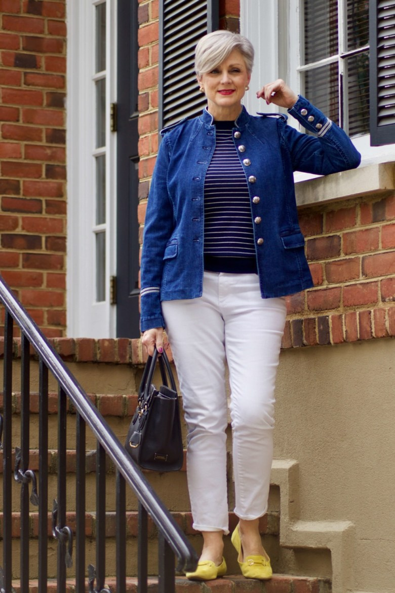 beth from Style at a Certain Age wears a Ralph Lauren denim officers jacket, white denim, striped sweater and yellow driving moccasins