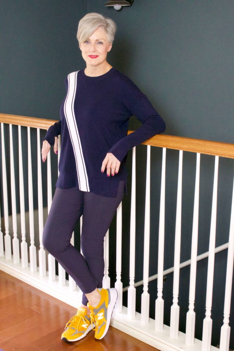 beth from Style at a Certain Age wears a travel outfit Athleta wander slim pants and streetwise sweater
