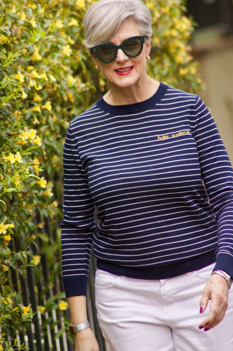 beth from Style at a Certain Age wears a stripe sweater