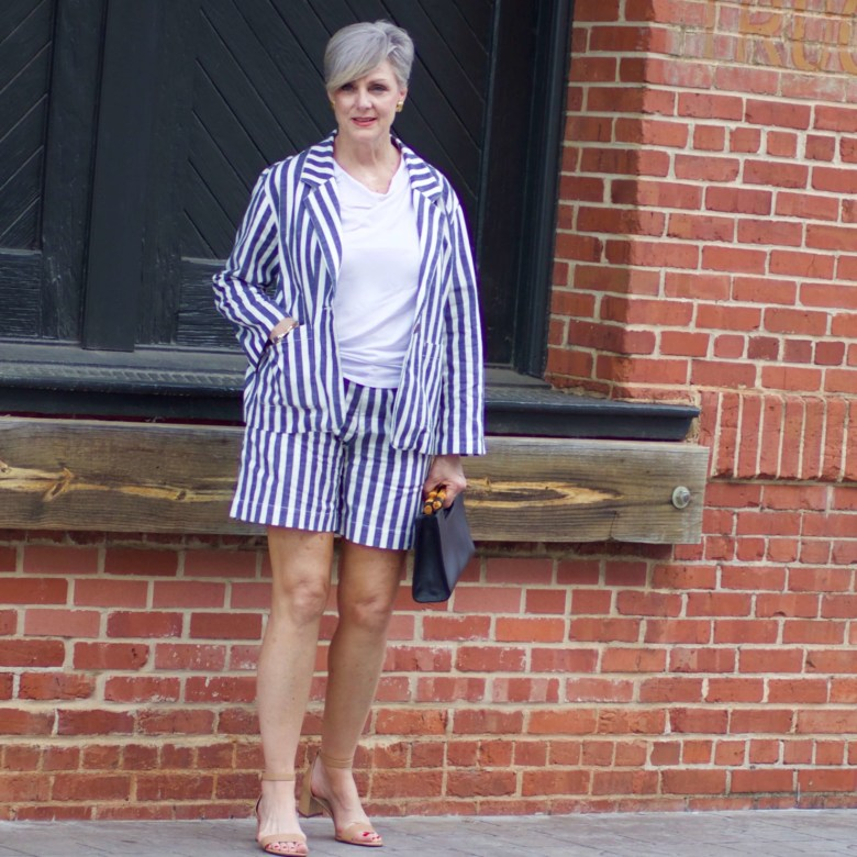 beth from Style at a Certain Age wears striped shorts, striped blazer, white tee, nude block heels