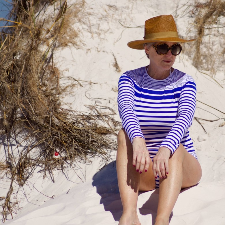 beth from Style at a Certain Age wears a Tommy Bahama Rash Guard and matching bottoms in Panama City Beach