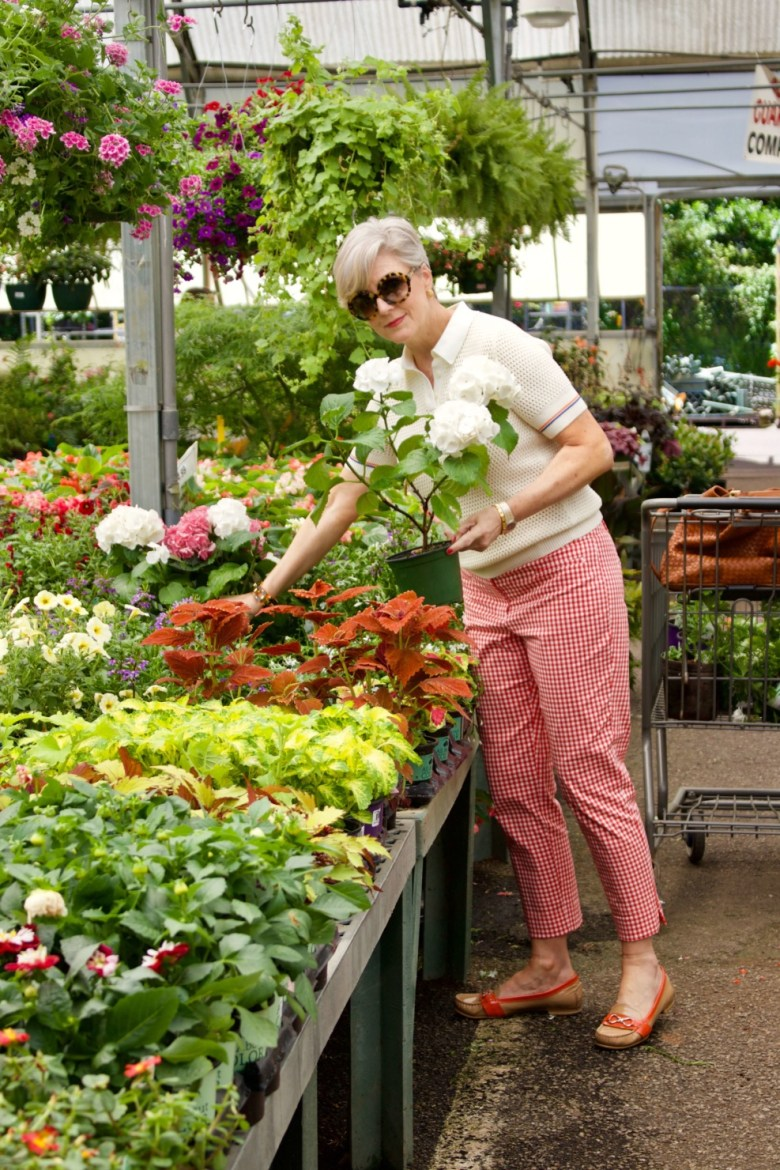 beth from Style at a Certain Age wears a Tory Burch short sleeve sweater, gingham pants, and Cole Haan loafers
