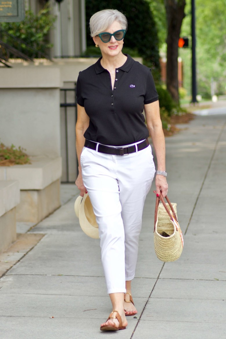 lacoste black polo, white chinos, brown sandals, straw tote