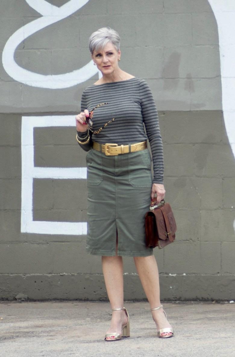 green pencil skirt, green striped tee, gold accessories