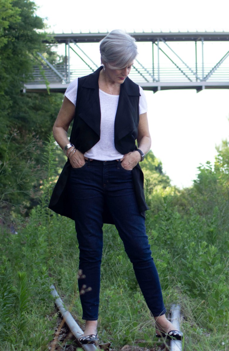 how to wear a black vest
