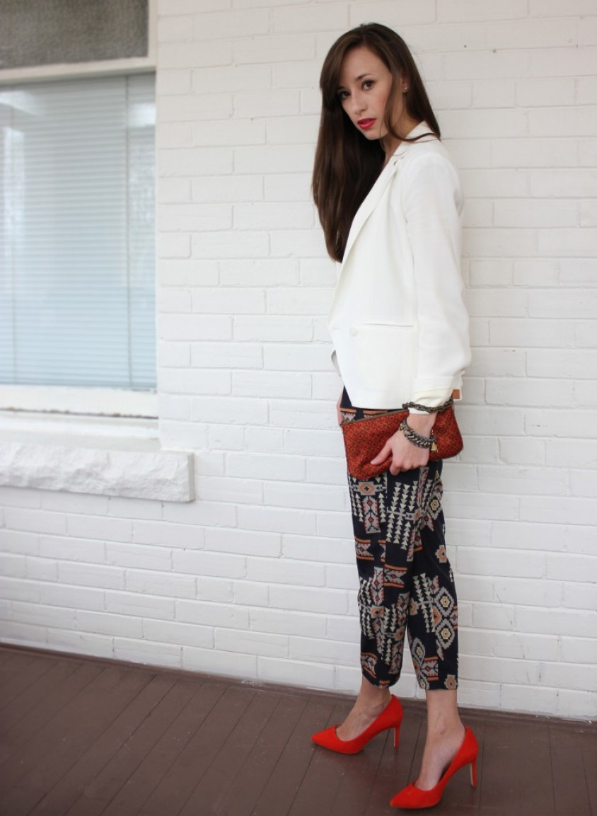 StyleBee wearing tribal pants, red shoes and a white blazer.