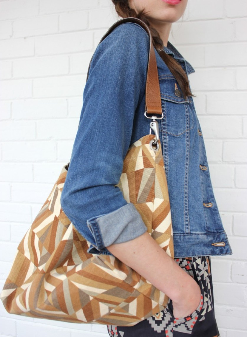 Girl in jeack jacket with patterned purse.