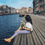 amsterdam canals bloemenmarkt girl champion flowers city travel blogger