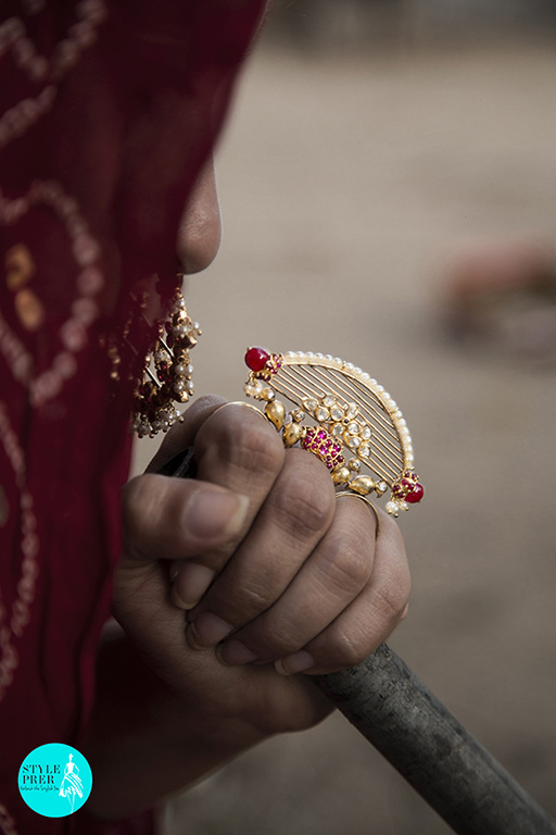 Wearing A Gold Plated Silver Three Finger Ring With Jaali And Bird Motif