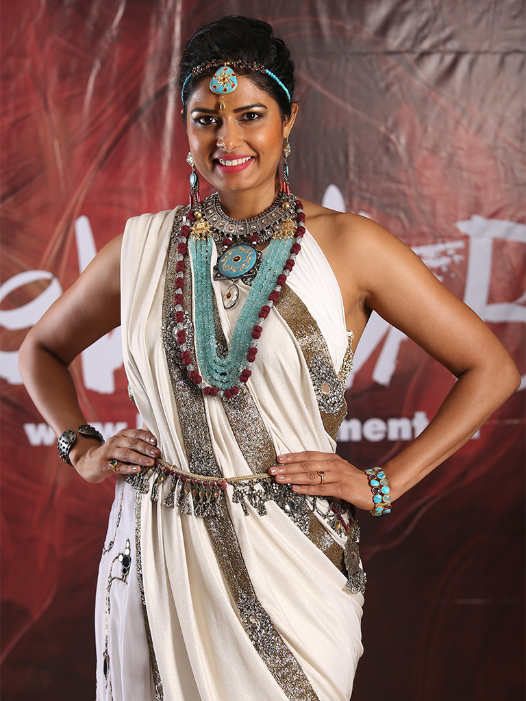 Priyanka Shah makes a style statement in handmade layered gemstone and silver jewelry by Sunaina Jain at the Beti Movement, an initiative by Anu Ranjan