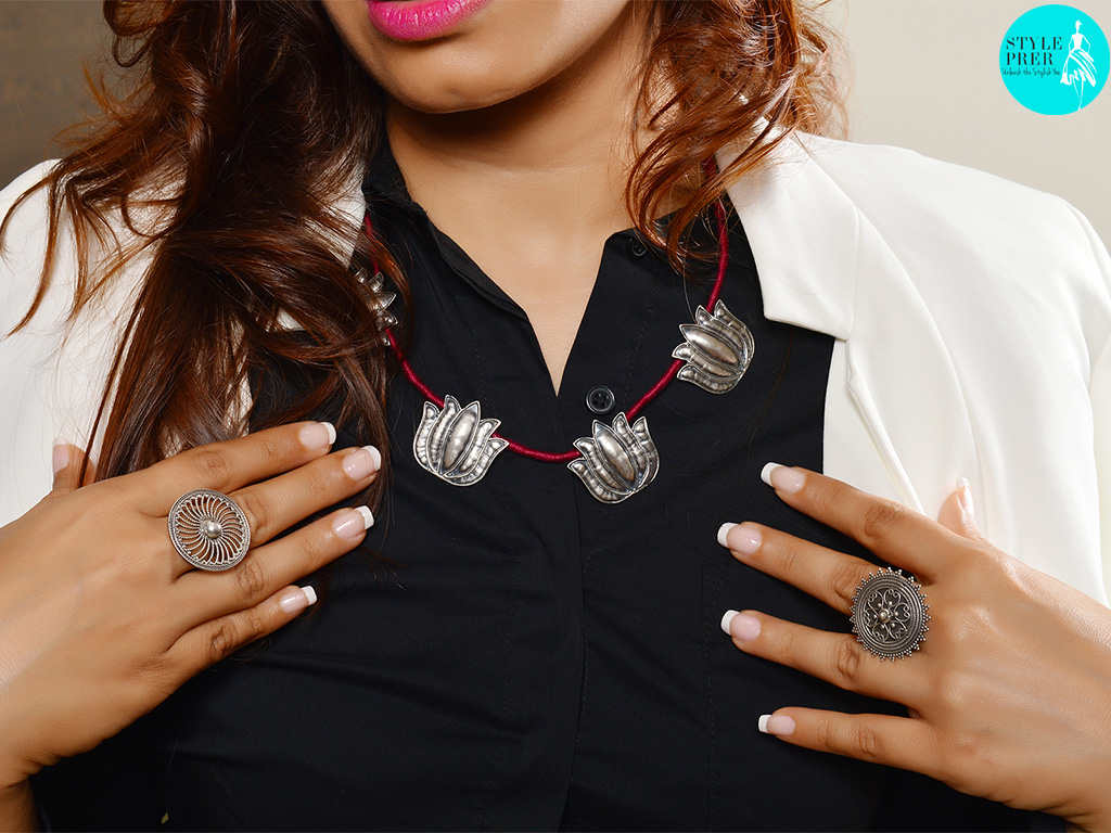 For the corporate look, I chose a lotus motif necklace along with two filigree rings over a black shirt, black pants and a white jacket. Jewelry available on Velvetcase.com