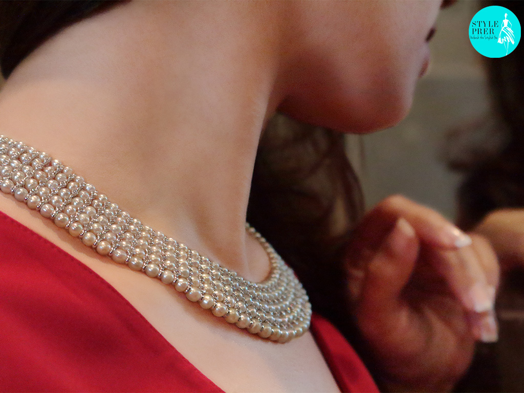 Adorning A Layered Woven Pearl Necklace Stationed With Diamonds