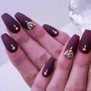 burgundy nails with gold design