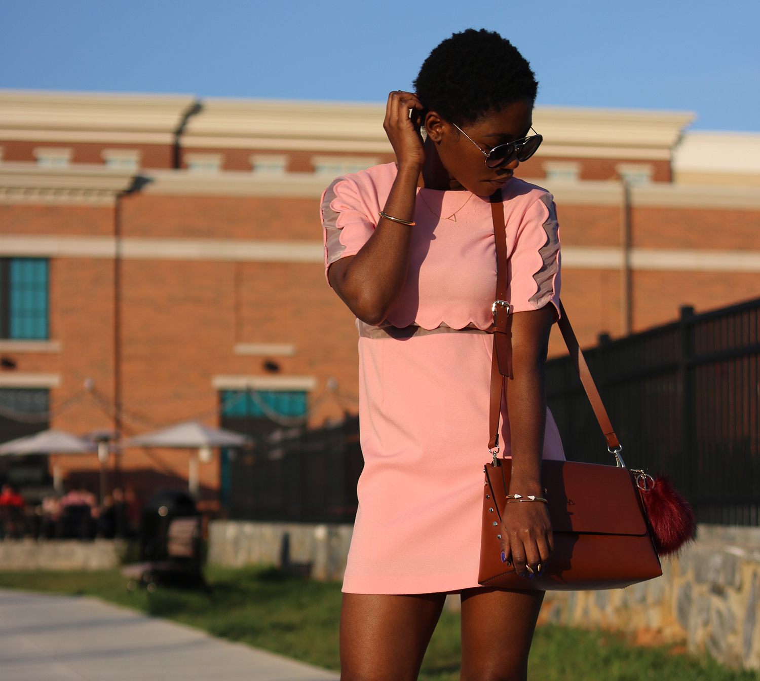 rust cross bag and scallop dress