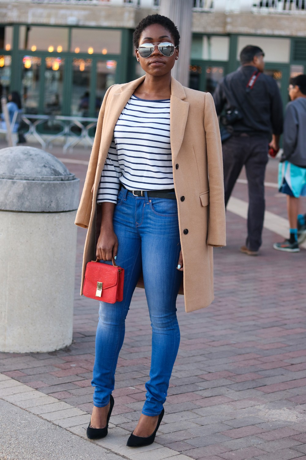 tan coat with denim jeans