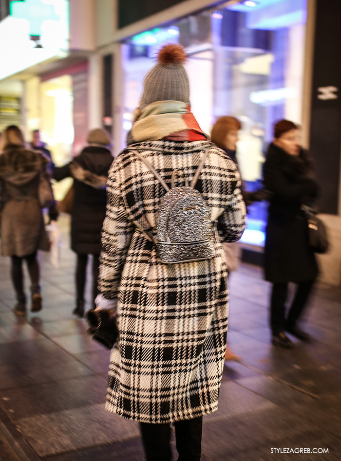 women's winter fashion what to wear street style how to wear plaid oversized coat, beanie and glitter backpack