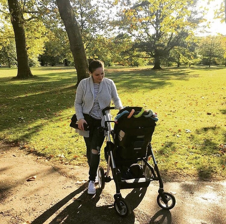 mummy with baby in pram in park