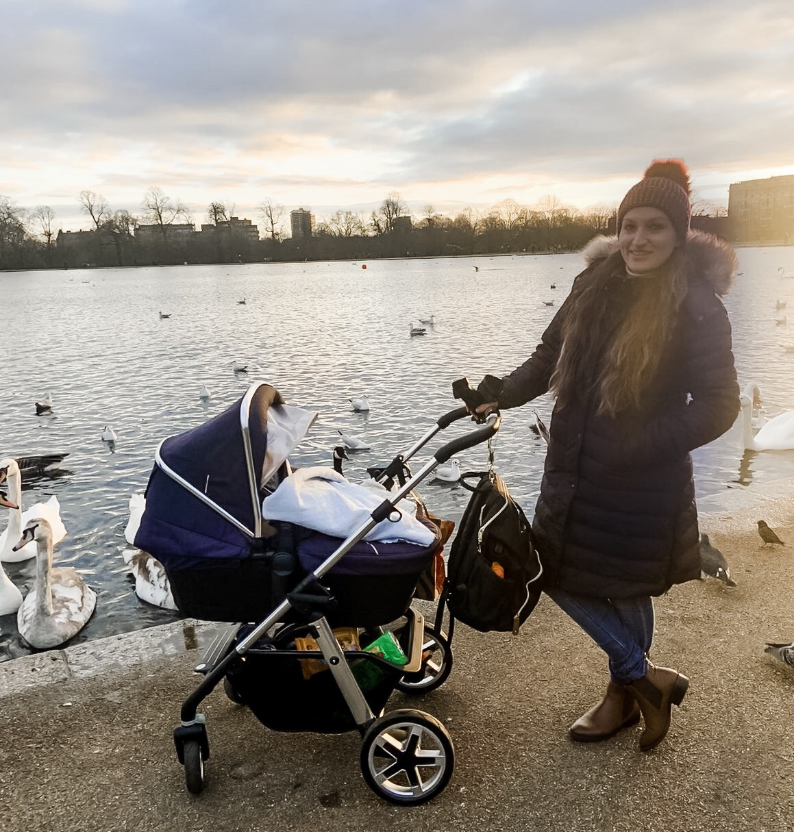 walk in park by lake with baby