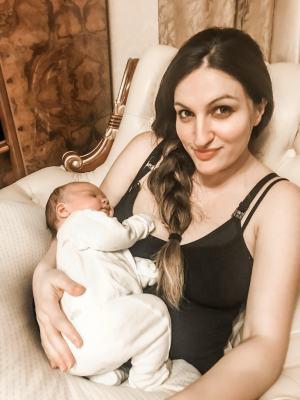 baby with mummy sitting sleeping