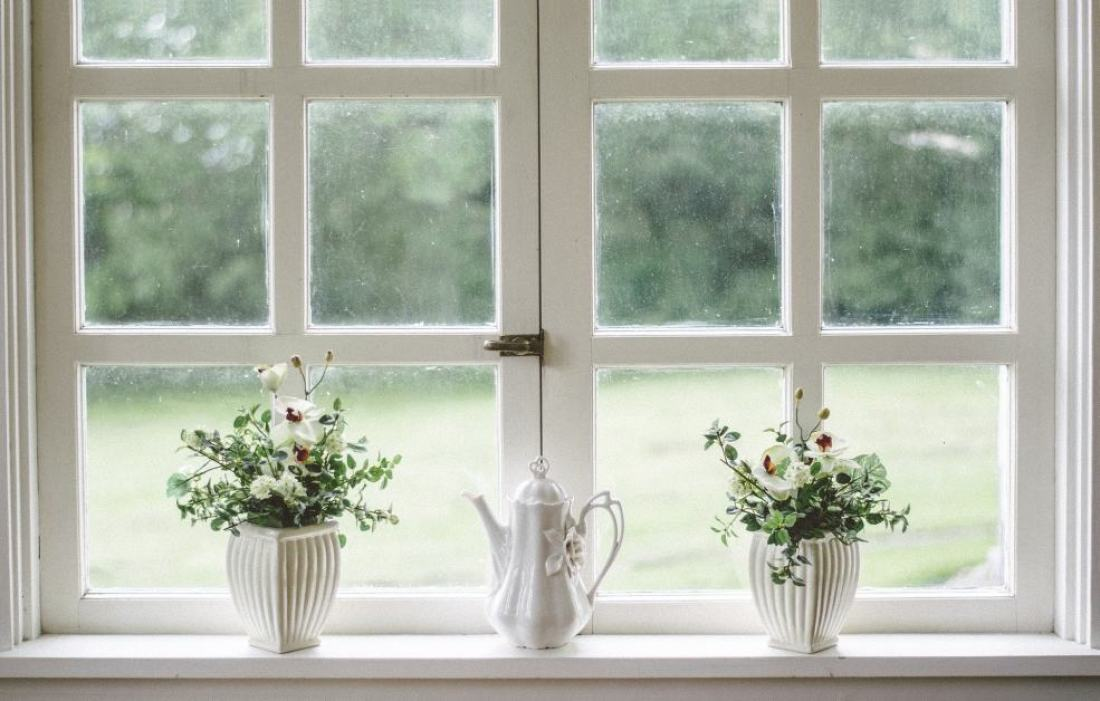 large white windows with plants on the window sill