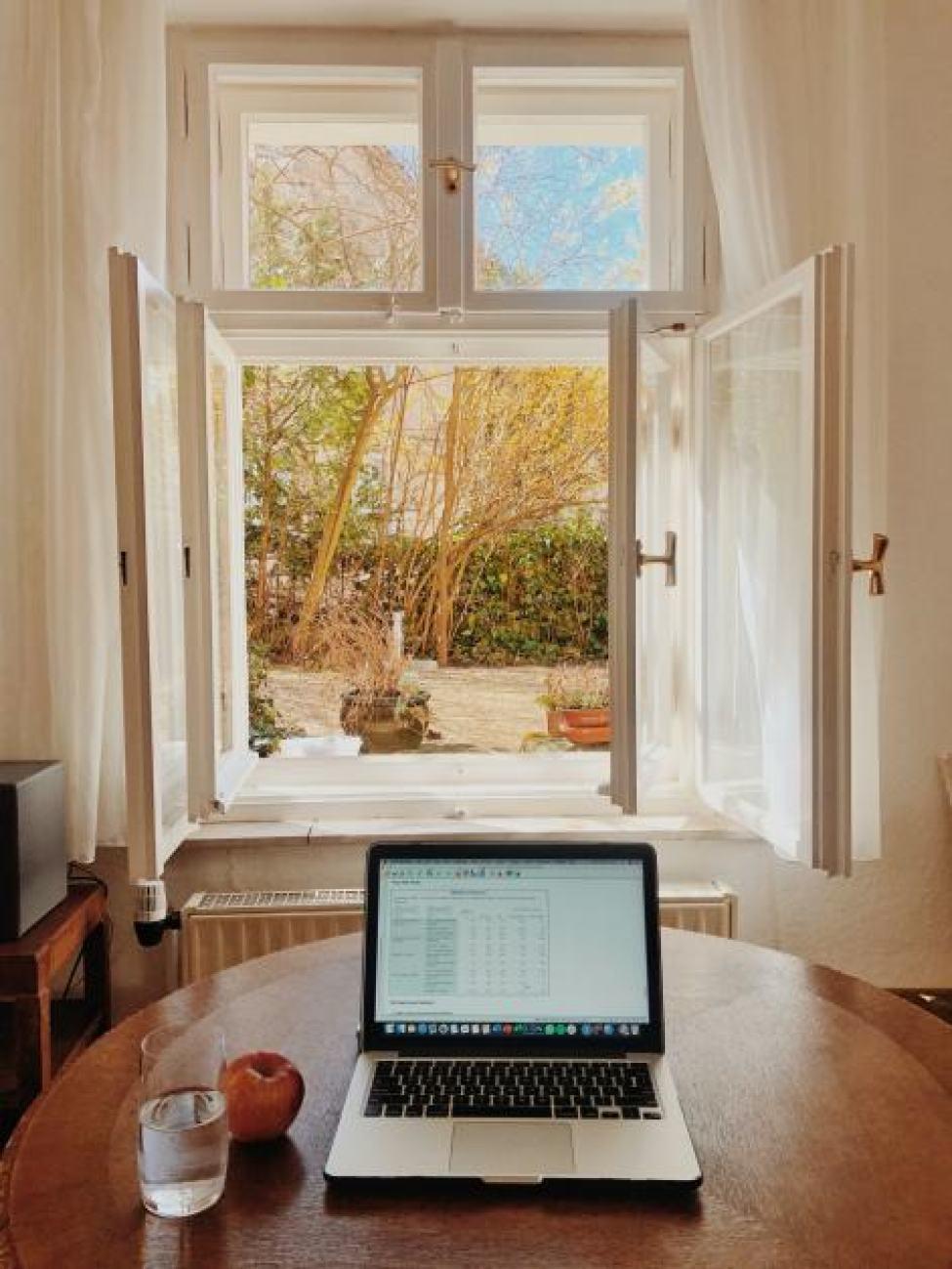 laptop in front of window