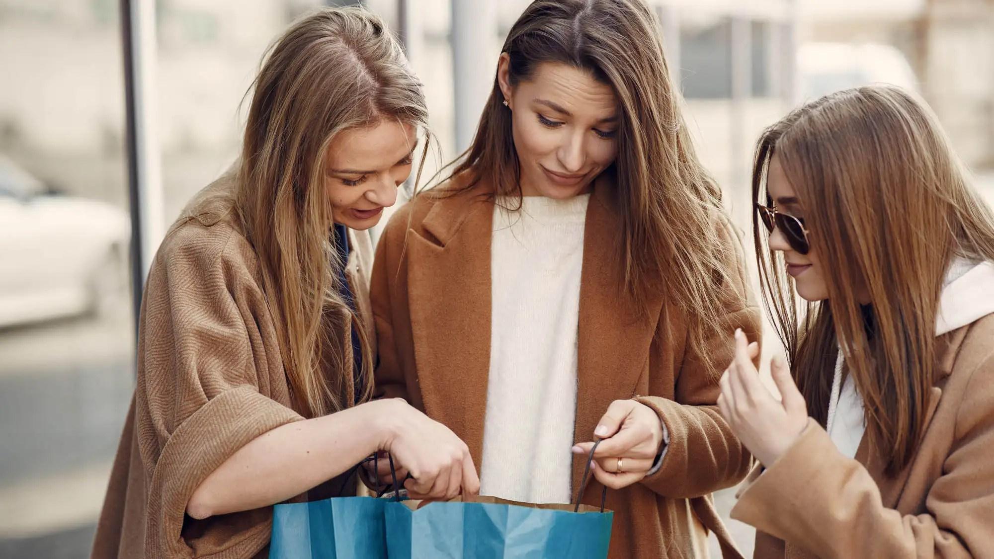 Girls on a shopping. Friends walks. Women with a shopping bags.