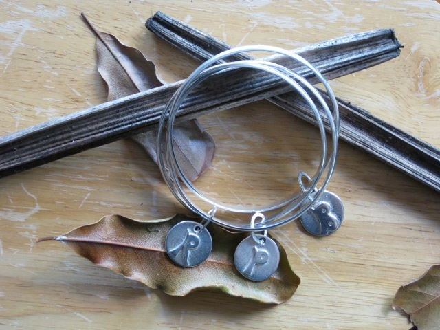Wild Poppy Designs hand-crafted silver bangles and charms
