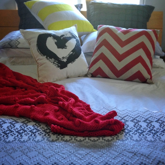 Bed | Freedom Furniture quilt cover, chevron red and neon yellow cushions | Pony Rider heart cushion | red cotton throw