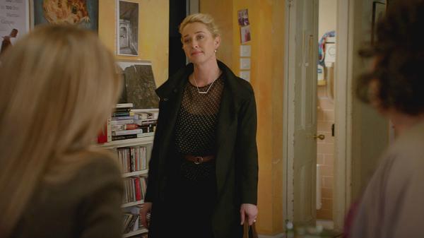 Offspring Season 6; Episode 10 | Nina Proudmand wears Scanlan Theodore black belted wool coat, Flannel silk black chiffon small dot top and silk slip dress