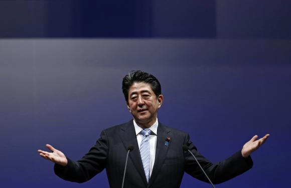Japan's PM Abe gestures as he delivers his speech during the ruling Liberal Democratic Party annual convention in Tokyo