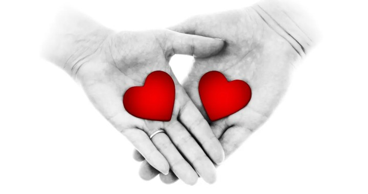Aftercare - two hands holding hearts